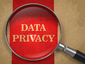 Data Privacy. Magnifying Glass on Old Paper with Red Vertical Line.