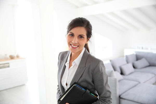 Real estate agent ready to present house to client